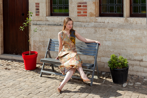 http://www.dreamstime.com/royalty-free-stock-photography-girl-dreaming-bench-front-antique-house-blond-caucasian-designer-dress-sun-old-image38927847